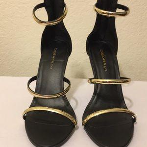 Classy Black/Gold Bebe high heels.